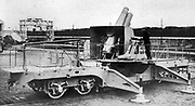 French army  200 millimetre (8-inch) howitzer mounted on transportable rail flatbed with adjustable stabilizing feet. The howitzer is an artillery piece with a short barrel, halfway between a gun and a mortar.