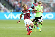 Mark Noble, West Ham United captain crosses the ball. Premier league match, West Ham Utd v AFC Bournemouth at the London Stadium, Queen Elizabeth Olympic Park in London on Sunday 21st August 2016.<br /> pic by John Patrick Fletcher, Andrew Orchard sports photography.