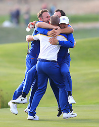 Team Europe's Alex Noren celebrates with team mates on the 18th green after his side win during the Ryder Cup at Le Golf National, Saint-Quentin-en-Yvelines, Paris. PRESS ASSOCIATION Photo. Picture date: Sunday September 30, 2018. See PA story GOLF Ryder. Photo credit should read: Gareth Fuller/PA Wire. RESTRICTIONS: Use subject to restrictions. Written editorial use only. No commercial use.