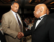 ATLANTA, GA - MAY 14:  Reverend Jesse Jackson and U.S. Congressman John Lewis (right) meet at the MLB Beacon Awards Banquet at the Omni Hotel on May 14, 2011 in Atlanta, Georgia.  (Photo by Mike Zarrilli/Getty Images)