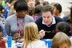 © Licensed to London News Pictures. 03/11/2014. LONDON, UK. Lorraine Pascale and The Deputy Prime Minister Nick Clegg sit with school children over lunch at Weston Park Primary School in Crouch End, London on Monday 3 November 2014. Photo credit : Tolga Akmen/LNP
