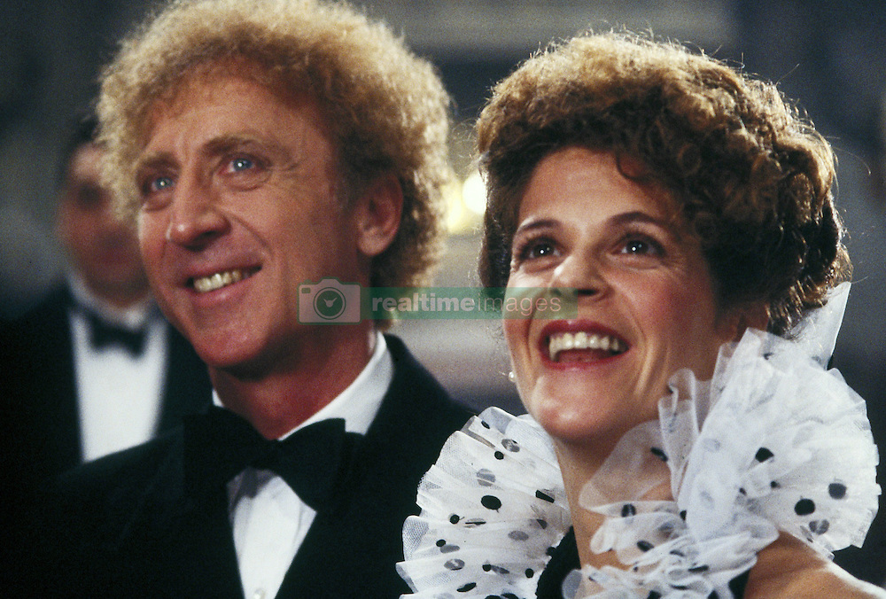 GENE WILDER, (born Jerome Silberman, June 11, 1933 - August 28, 2016) was an American stage and screen comic actor, screenwriter, film director, and author. He was known best for the lead role in the 1971 film 'Willy Wonka in Willy Wonka & the Chocolate Factory,' and the Mel Brooks comedies 'Blazing Saddles', and 'Young Frankenstein', which Wilder co-wrote, garnering the pair an Academy Award nomination for Best Adapted Screenplay. Wilder died at age 83 from complications from Alzheimer's disease. PICTURED: GENE WILDER and GILDA RADNER in a scene from the 1986 film 'Haunted Honeymoon.' (Credit Image: © Orion Pictures/Entertainment Pictures/ZUMAPRESS.com)