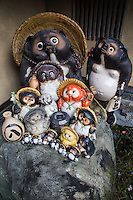 Tanuki Family - Tanuki is the Japanese word for a raccoon.  These creatures have been represented in Japanese folklore for hundreds of years.  The tanuki have a reputation for being mischievous.  At the same time they are jolly, good at disguising themselves. They are also absent-minded. and gullible according to legend.