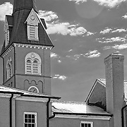 The St. George Episcopal Church steeple in Fredericksburg, VA dominates the skyline from an alley off of William Street.