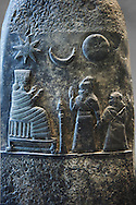 Stone Sculpture depicting  Kassite or 3rd Dynasty of Babylon King Meli-Shipak II commemorating a donation of land to his daughter-Hannubat Nannaya. Circa 1186-1172 BC excavated from Susa where it had been taken as a spoil of war. The king dressed in a long robe with his right hand raised in a gesture of greeting. With his left hand he grasps the wrist of his daughter. The princess carries in her left hand a nine-stringed harp. Both face an enthroned goddess Nanya, a deity worshipped especially at Uruk[, who is dressed in a flounced or segmented garment and donning a feathered mitre and sits on the far side of a cultic censer on a stand. Above them are the symbols of three divinities astral: the star of Ishtar, the sun god Shamash and Sin of the crescent moon are in the sky. The rest of the stele has been entirely defaced, possibly by an Elamite king intending to have his own inscription engraved. The Louvre Museum, Paris. .<br /> <br /> If you prefer to buy from our ALAMY PHOTO LIBRARY  Collection visit : https://www.alamy.com/portfolio/paul-williams-funkystock/babylon-antiquities.html    Type -     Louvre   - into the LOWER SEARCH WITHIN GALLERY box to refine search by adding background colour, place, museum etc<br /> <br /> Visit our ANCIENT WORLD PHOTO COLLECTIONS for more photos to download or buy as wall art prints https://funkystock.photoshelter.com/gallery-collection/Ancient-World-Art-Antiquities-Historic-Sites-Pictures-Images-of/C00006u26yqSkDOM