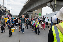 London, UK. 5th June, 2021. Environmental activists and local residents protest against the construction of the Silvertown Tunnel. Campaigners opposed to the controversial new £2bn road link across the River Thames from the Tidal Basin Roundabout in Silvertown to Greenwich Peninsula argue that it is incompatible with the UK's climate change commitments because it will attract more traffic and so also increased congestion and air pollution to the most polluted borough of London.