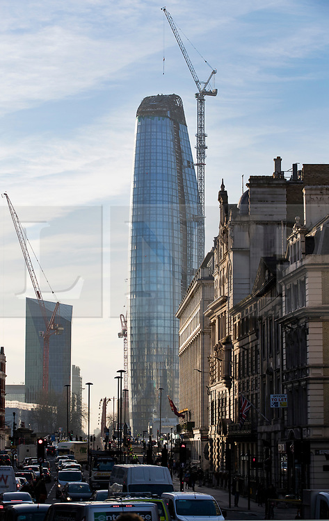 © Licensed to London News Pictures. 19/12/2017. London, UK. Construction workers brave the cold as they work at the top of 'One Blackfriars' sky scraper next to the River Thames, as parts of the UK are hit by fog and frost with travel disruption expected. The 52 storey apartment block began construction in 2013 and is 535 feet tall. Photo credit: Peter Macdiarmid/LNP