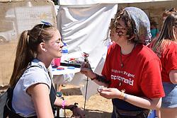 Latitude Festival, Henham Park, Suffolk, UK July 2018. Action Aid face painting