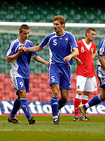 Photo: Leigh Quinnell.<br /> Wales v Slovakia. UEFA European Championships 2008 Qualifying. 07/10/2006. Stanislav Varga(R) congratulates Marek Mintal after scoring Slovakias second goal.