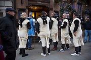 Group of friends on a Christmas day out in central London, UK. Dressed as Bo Peep and a flock of sheep, after the popular nursery rhyme.