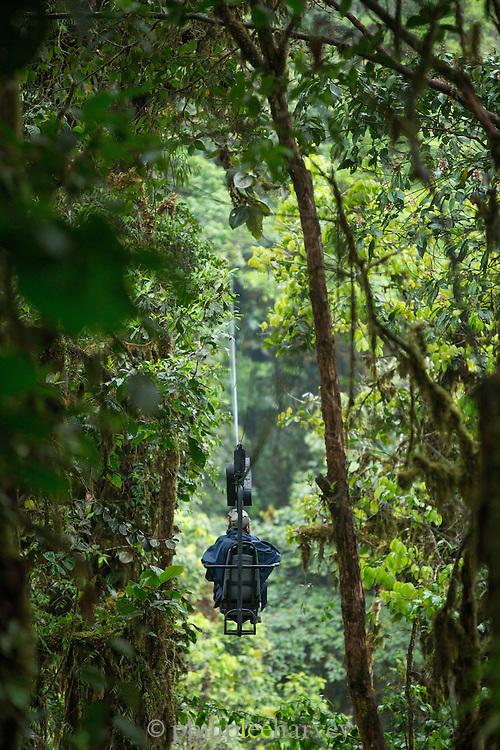 Tourists on Mashpi Lodge Sky Bike, Mashpi Reserve, Ecuador