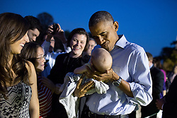 President Barack Obama holds a baby during the Congressional Picnic on the South Lawn of the White House, Sept. 17, 2014. (Official White House Photo by Pete Souza)<br /> <br /> This official White House photograph is being made available only for publication by news organizations and/or for personal use printing by the subject(s) of the photograph. The photograph may not be manipulated in any way and may not be used in commercial or political materials, advertisements, emails, products, promotions that in any way suggests approval or endorsement of the President, the First Family, or the White House.
