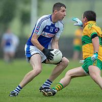 St. Senan's Kilkee's Barry Harte tries to get around  O'Curry's Damian Carmody