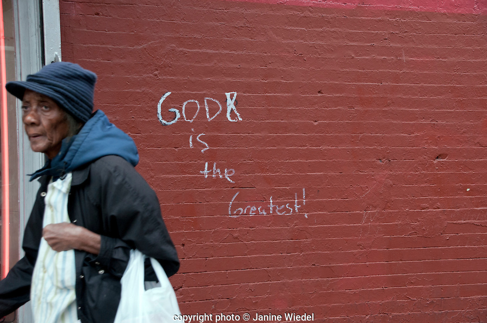 Message about God written on wall in Harlem New York City