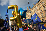 Anti Brexit pro Europe demonstration with EU balloons in Westminster on 27th March 2019 in London, England, United Kingdom. With the date of the UK leaving the European Union extended, the pro EU protest continues as MPs from all sides try to gain control of the process, as they debate the various options in the commons.