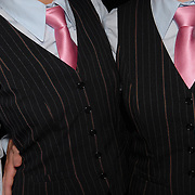 Petra Ritler, left, and Kirsten Hierholz, of Frankfurt, Germany, pose for a photo dressed in  men's suits for the women's adult standard division of the same-sex ballroom dancing competition during the 2007 Eurogames at the Waagnatie hangar in Antwerp, Belgium on July 14, 2007. ..Over 3,000 LGBT athletes competed in 11 sports, including same-sex dance, during the 11th annual European gay sporting event. Same-sex ballroom is a growing sports that has been happening in Europe for over two decades.