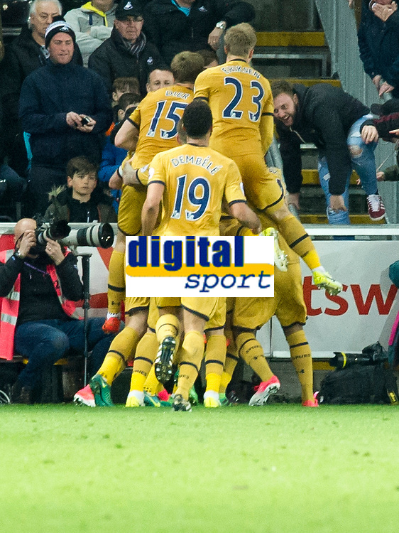 Football - 2016 / 2017 Premier League - Swansea City vs. Tottenham Hotspur<br /> <br /> A Spurs fan jump on to the pitch as Heung-Min Son of Tottenham Hotspurs celebrates scoring his team's second goal in front of spurs fans , at The Liberty Stadium.<br /> <br /> COLORSPORT/WINSTON BYNORTH