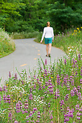 A 35-year-old woman walks on a paved trail in Fayetteville, Arkansas.