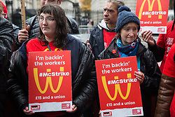 London, UK. 12 November, 2019. McDonald's workers belonging to the Bakers Food & Allied Workers Union (BFAWU) assemble opposite Downing Street during strike action, dubbed a 'McStrike', to call for a New Deal for McDonald's Workers which would include £15 an hour, an end to youth rates, the choice of guaranteed hours of up to 40 hours a week, notice of shifts four weeks in advance and union recognition.