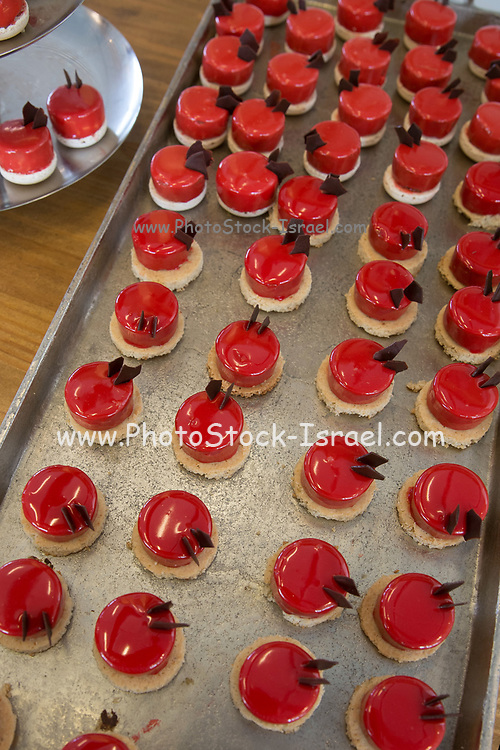 Strawberry flavoured mousse on a buffet table