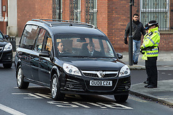 © Licensed to London News Pictures . 16/01/2014 . Salford , UK . Police bow their heads as the cortege arrives . The funeral of Labour MP Paul Goggins at Salford Cathedral today (Thursday 16th January 2014) . The MP for Wythenshawe and Sale East died aged 60 on 7th January 2014 after collapsing whilst out running on 30th December 2013 . Photo credit : Joel Goodman/LNP