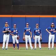 NEW YORK, NEW YORK - June 21: Waiting to field fly balls at batting practice are, from left, Noah Syndergaard #34, Sean Gilmartin #36, Steven Matz #32, Erik Goeddel #62 and Jacob deGrom #48 of the New York Mets before the Kansas City Royals Vs New York Mets regular season MLB game at Citi Field on June 21, 2016 in New York City. (Photo by Tim Clayton/Corbis via Getty Images)