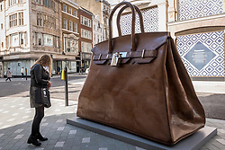 "© Licensed to London News Pictures. 01/10/2020. LONDON, UK. ""Bag of Aspirations"", 2019, by Kalliopi Lemos is displayed outside Fenwick department store on New Bond Street as part of the inaugural Mayfair Sculpture Trail which will be on show to the public for the month of October.  The sculpture trail forms part of the seventh, annual edition of Mayfair Art Weekend which celebrates the rich cultural heritage of Mayfair as one of the most internationally known, thriving art hubs in the world with free exhibitions, tours, talks and site-specific installations available to the public.  Photo credit: Stephen Chung/LNP"