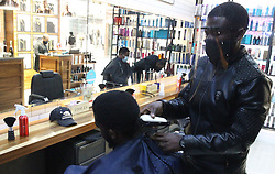 South Africa - Pretoria - 1 July 2020 - Tshilidzi Mudzusi gets a haircut from Kingwiti Daddy at Edge barber shop, Menlyn Retail Park.<br />Picture: Jacques Naude/African News Agency(ANA)