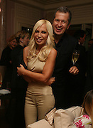 DONATELLA VERSACE AND MARIO TESTINO, Dinner hosted by Elizabeth Saltzman for Donatella Versace. Claridge's Hotel, Brook Street, Mayfair, London. 11 March 2008.  *** Local Caption *** -DO NOT ARCHIVE-© Copyright Photograph by Dafydd Jones. 248 Clapham Rd. London SW9 0PZ. Tel 0207 820 0771. www.dafjones.com.