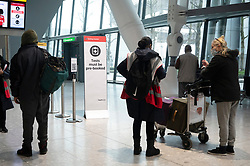 © Licensed to London News Pictures. 19/01/2021. London, UK. Arriving traveller speak with staff  at a Covid-19 test centre in Heathrow Airport near London. Travel corridors in the the UK were closed at 04:00 hours on 18 January 2021 as British government declared. Travellers arriving to England from anywhere outside the UK have to to self-isolate for 10 days and must have proof of a negative coronavirus test. Photo credit: Ray Tang/LNP