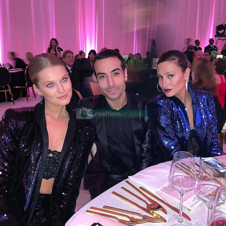 """Toni Garrn releases a photo on Instagram with the following caption: """"Family viewing party @ejaf THANK YOU @sisso86 for always making this possible #Oscars2019 \u2728 (ignore the creepy eyes, @moalturki is sleep retouching \ud83d\ude48)"""". Photo Credit: Instagram *** No USA Distribution *** For Editorial Use Only *** Not to be Published in Books or Photo Books ***  Please note: Fees charged by the agency are for the agency's services only, and do not, nor are they intended to, convey to the user any ownership of Copyright or License in the material. The agency does not claim any ownership including but not limited to Copyright or License in the attached material. By publishing this material you expressly agree to indemnify and to hold the agency and its directors, shareholders and employees harmless from any loss, claims, damages, demands, expenses (including legal fees), or any causes of action or allegation against the agency arising out of or connected in any way with publication of the material."""