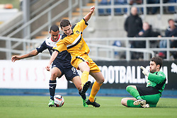 Falkirk's Phil Roberts and Dumbarton's Paul McGinn and Dumbarton's goalkeeper Jamie Ewings.<br /> Falkirk 1 v 2 Dumbarton, Scottish Championship game played today at the Falkirk Stadium.<br /> ©Michael Schofield.