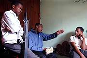 Marvin, 20 years old, former gangster, teaching a life orientation lesson to young neglected youngsters in the School of Hope in Athlone, Cape Town, RSA, where troubled young kids at risk are getting education (run by Thembalitsha.org.za a local NGO). Marvin was a hit-man, working also for different gang such as 'The Americans' and the 'Junior Mafia' between the age of 15 and 19. He grow up in the mainly 'coloured' area of  Heideveld, where unemployment is rife and gangs are flourishing. He was also addicted by crystal meth (aka 'tik'), a dangerous chemical drug very common in South Africa's poorest neighbourhoods. Thanks to his family, after having been to reformatory, he was helped to get out of the gangs and to join a free academy for skills development aimed at empowering troubled youths through training and discipline, called Chrysalis (www.chrysalisacademy.org.za). He finished a three month course there and he is now about to  start working in the tourism industry; he know the wrongs has done and he does not want to go back to that life anymore. Chrysalis aim at reducing the levels of crime and violence in the Western Cape by transforming 'youth at risk' into strong, positive community leaders of the future through intensive continuous training. ?After I left the gang I was working for in the Woodstock area of Cape Town I have made myself some enemies; I cannot go back there anymore because someone has still anger left for me?I don?t want that life anymore, I want to live peacefully and fulfil my aspirations, you see: it is a matter of having little short-term goals, once you have achieved one you go onto the next, and so on. Always think you can do it, don?t give up, go for it again. I was running in dark corners, there was no way out, I did not have a goal, I had no dreams. You need to believe that you are worthwhile. Life is hard, it depends on you on how you want to make your life. Make everyday your day.""
