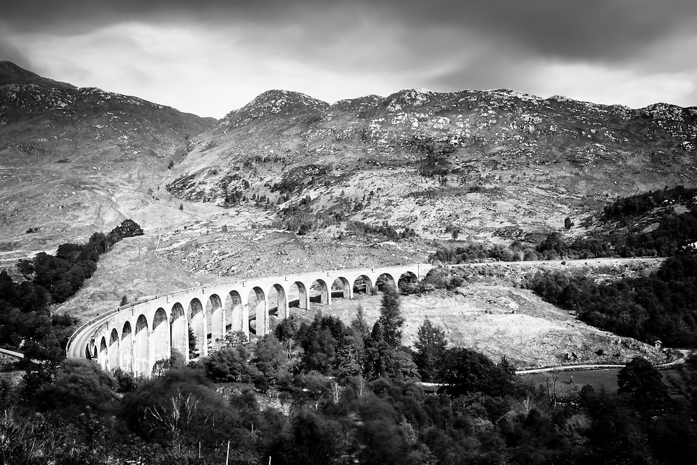Black and white panorama of the Glenfinnan Viaduct, made famous by the Harry Potter movies and the Hogwart's Express.