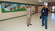 Hilliard Elementary School principal Mike Walker, left, works to prepare his new school for students, July 1, 2013.