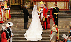Prince William and his bride Kate take their vows during their wedding at Westminster Abbey, London.