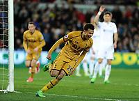 CELE - Tottenham Hotspur's Dele Alli celebrates scoring his sides equalising goal to make the score 1-1<br /> <br /> Photographer Ashley Crowden/CameraSport<br /> <br /> The Premier League - Swansea City v Tottenham Hotspur - Wednesday 5th April 2017 - Liberty Stadium - Swansea<br /> <br /> World Copyright © 2017 CameraSport. All rights reserved. 43 Linden Ave. Countesthorpe. Leicester. England. LE8 5PG - Tel: +44 (0) 116 277 4147 - admin@camerasport.com - www.camerasport.com
