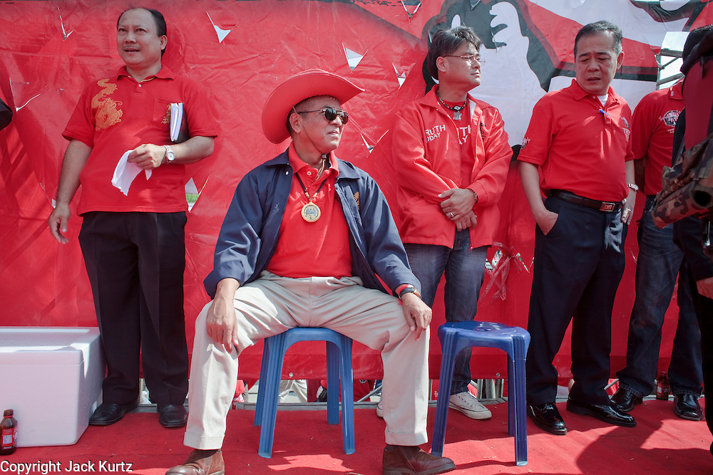 """Mar. 26, 2009 -- BANGKOK, THAILAND: Veera Musigapong, a leader of the United Front of Democracy Against Dictatorship (UDD), waits to speak at a UDD rally in Bangkok Thursday. Veera was a deputy leader of former Prime Minister Thaksin Shinawatra's party. More than 30,000 members of the United Front of Democracy Against Dictatorship (UDD), also known as the """"Red Shirts""""  and their supporters descended on central Bangkok Thursday to protest against and demand the resignation of current Thai Prime Minister Abhisit Vejjajiva and his government. Abhisit was not at Government House Thursday. The protest is a continuation of protests the Red Shirts have been holding across Thailand in March.  Photo by Jack Kurtz"""