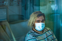 © Licensed to London News Pictures . 12/02/2021 .  Manchester , UK . Portrait of patient KIERAN CRAGGS (25 from Whalley Range) , who is isolated on a bay on Ward 4 , the Respiratory Cohort Area . Patients are being kept further apart within bays on wards to minimise the risk of virus transmission amongst patients . Inside Manchester Royal Infirmary , where patients are being treated for the effects of Coronavirus . Photo credit : Joel Goodman/LNP