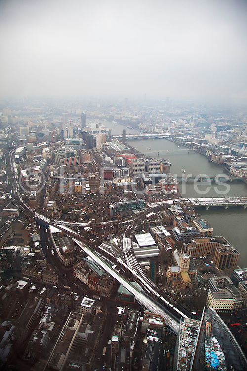 London, UK. Wednesday 23rd January 2013. The View from The Shard. This visitor attraction is the highest vantage point from any building in Western Europe and casts stunning views across the capital. The public viewing deck on level 69 and 72 offers a 360 degree view of the city. River Thames towards central London.