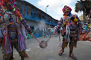 """Feast of """"Mamacha del Carmen"""" of Paucartambo. Guerrilla. The extrs smoke the audience with a fumigant pepper"""