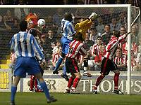 Photo Aidan Ellis, Digitalsport<br /> NORWAY ONLY<br /> <br /> Lincoln City v Huddersfield Town.<br /> Third Divison Play Off Semi Final 1st leg.<br /> 15/05/2004.<br /> Huddersfield's iffy Onuora beats Licoln keeper Alan Marriott to head in the first goal