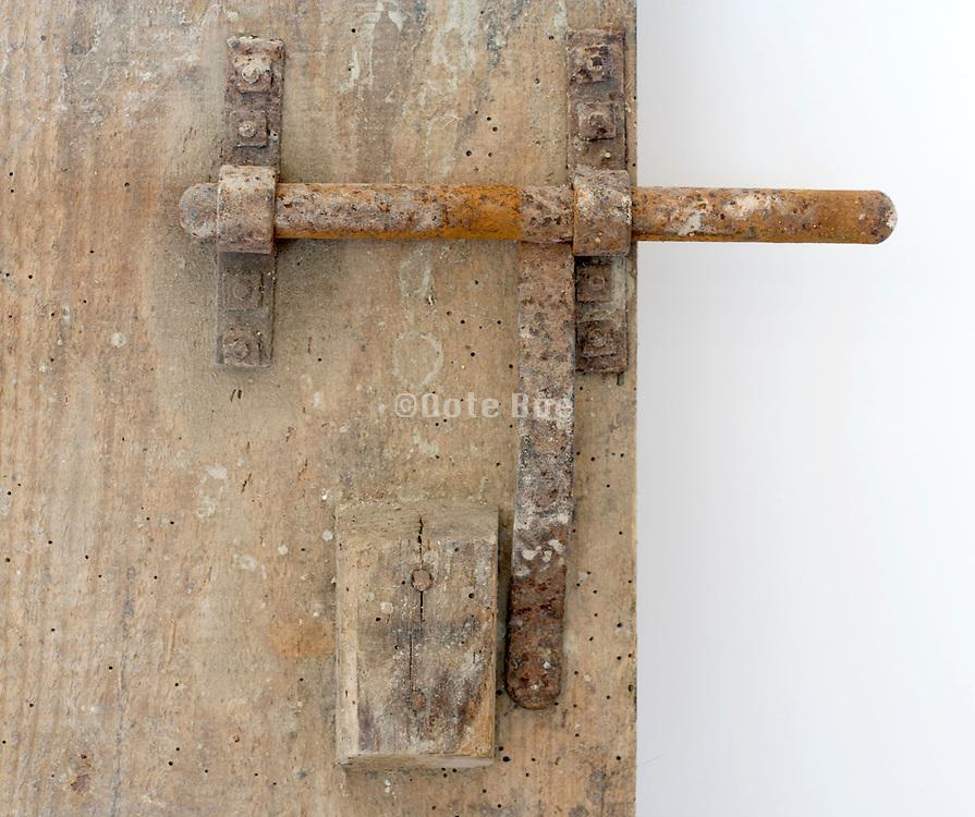 old rusty metal bold on wooden door