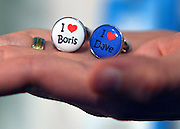 "© Licensed to London News Pictures. 03/10/2012. Birmingham, UK A stall holder holds up a pair of cufflinks which say ""I love Boris"" and ""I love Dave"" on Day 1 at The Conservative Party Conference at the ICC today 7th October 2012. Photo credit : Stephen Simpson/LNP"