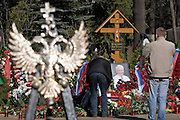 Moscow, Russia, 26/04/2007..Russians visit Boris Yeltsin's grave to pay their last respects after Novodevichy Cemetery was  reopened to the public on the day following the former Russian President's funeral. Mourners at the grave in the shadow of the Russian state symbol of a double headed eagle..