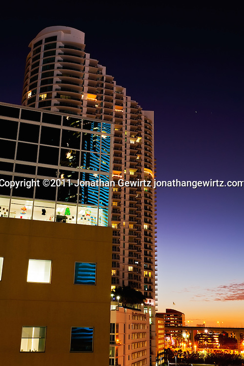 Twilight view of office and condo buildings near Miami's downtown, showing Christmas decorations and colorful reflections. WATERMARKS WILL NOT APPEAR ON PRINTS OR LICENSED IMAGES.