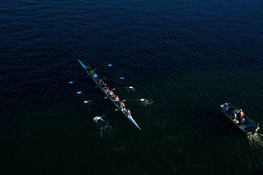 Skulling team practicing on the Willamette River in downtown Portland Oregon