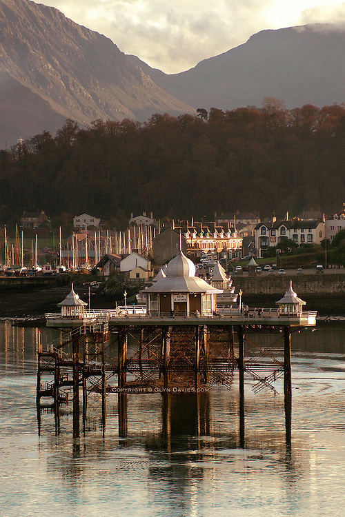 Available as unlimited A3 & A4 prints only<br /> <br /> Bangor Pier and the Nant Ffrancon Valley as seen from Anglesey