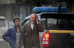A victim walks with his son towards hospital at the site of a suicide car bombing in Kabul, Afghanistan, on Jan. 16, 2013. A powerful blast rocked Afghan capital Kabul on Wednesday leaving over a dozen dead and injured, an eye witness said,  January 16, 2013. Photo by Imago / i-Images...UK ONLY