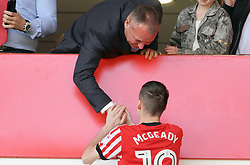 Prospective new Sunderland owner Stewart Donald speaks to a Sunderland fan in the stands during the Sky Bet Championship match at the Stadium of Light, Sunderland.